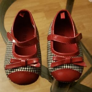 Size 6-12 month babygirl shoes, new.
